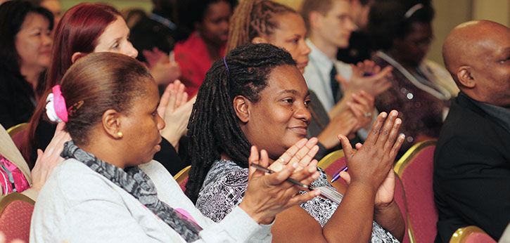 Workshop participants applaud at the end of a National Family Engagement Conference presentation.