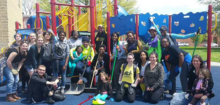 Community school students, staff, and volunteers help cleanup a playground in West Baltimore.