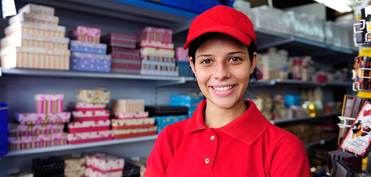 A young woman works in a retail environment.