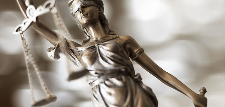 Statue of Lady Justice holding scales