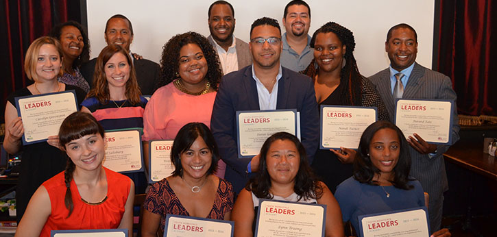 The 2016 class of D.C. Youth Workforce Leaders Academy hold up their certificates of completion.