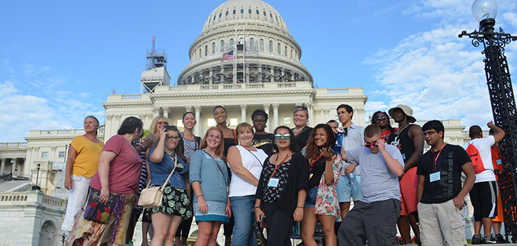 A group of RAMP youth, mentors, family members, and program staff pose in front of the U.S. Capitol Building.