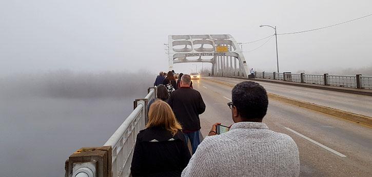 Participants in IEL's Civil Rights Bus Tour prepare to cross the fog-ensconced Edmund Pettus Bridge in Selma, Ala.