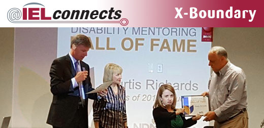 Rebecca Cokely presents a certificate to Curtis Richards, inducting him into the Disability Mentoring Hall of Fame.