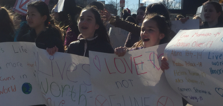 Students carrying signs against gun violence