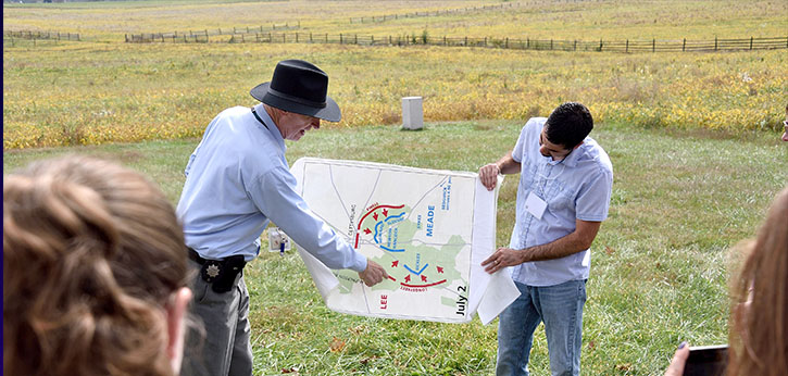 Two officials in rural Appalachia unveil new development plans in front of local press and community members.