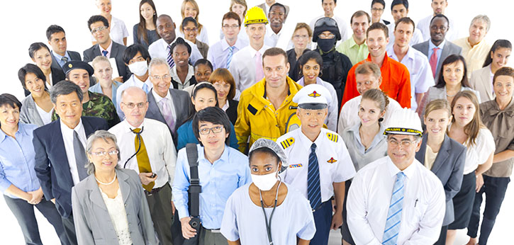 A large group of diverse adults dressed for a wide variety of careers.