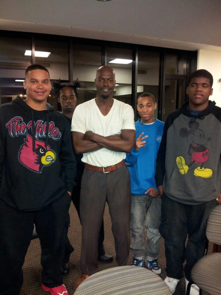 Students with teacher at Louisville book reading event