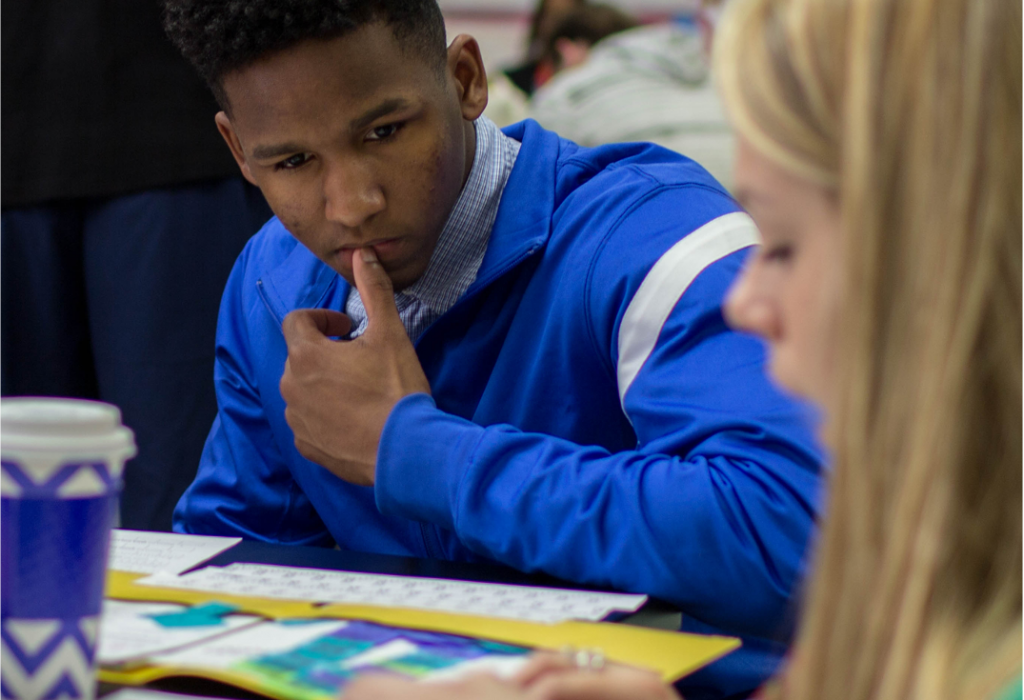 High school students work on classwork with each other